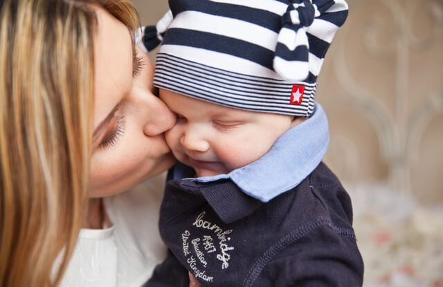 baby-with-mom-mother-kiss-tenderness